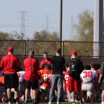 Ohio State head coach Urban Meyer speaks to his players during a huddle near the beginning of practice on Tuesday, October 27, 2016 at Notre Dame Preparatory High School in Scottsdale. He is attempting to lead his team to its seventh Fiesta Bowl victory. (Photo by Logan Newman/Cronkite News)